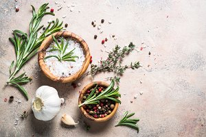 Spices and herbs background - thyme, rosemary, pepper and sea sa