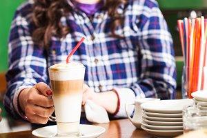 Barista is preparing latte