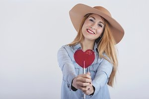 girl with heart shaped lollipop