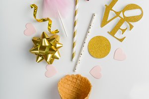 Valentine's day concept - ice cream cone and party decorations