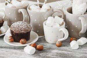 Cupcakes and cups with cacao
