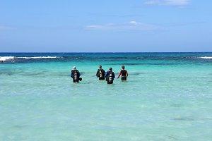 Divers. Nissi-Beach. Cyprus.