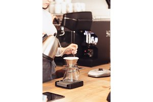 Hand drip coffee, Barista pouring water on coffee ground with filter