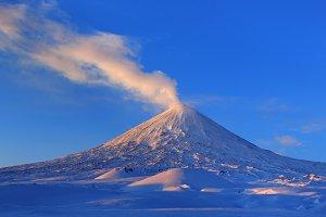 Active volcano landscape at sunrise