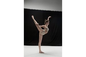 Young teen dancer on white floor background.