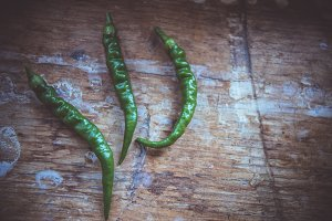 Green peppers on wood