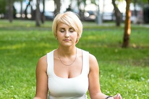 Girl meditating in park
