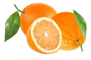 Two whole and half orange with leaf