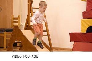 Boy playing in the nursery.