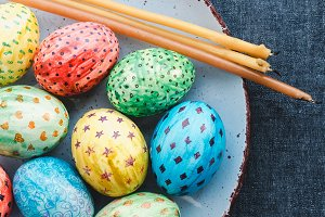 Easter eggs, painted with bright colors and candles