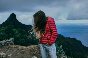 Pretty girl of background of mountain landscape