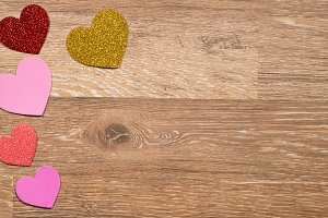 Heart shapes on wooden surface for Valentine's Day