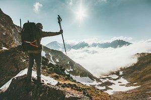 Traveler Man on mountain summit