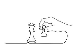 Hand holding chess