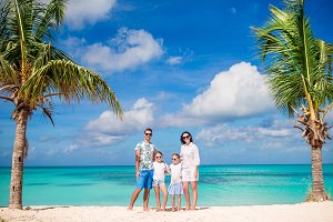 Family in white on the beach on caribbean vacation