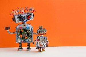Creative design Robotic family. Big robot electrical wire hairstyle, plug arm. Small kid cyborg with lamp bulb toy. Copy space, orange wall background