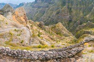 Vertiginous steel trekking trails leads between huge rocks down to the Coculi valley. Santo Antao Island, Cape Verde