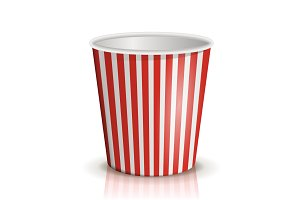An empty red-and-white striped bucket of popcorn.