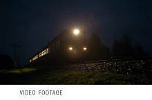Train passing fast through a rural