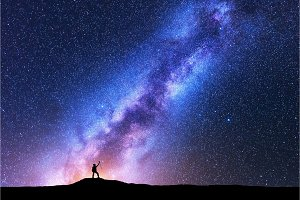 Milky Way and silhouette of happy woman. Space