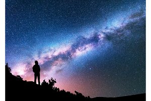 Silhouette of man against night sky with Milky Way