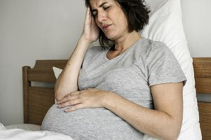 Pregnant woman with a headache