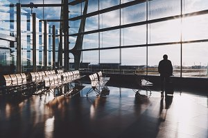 Silhouette of traveler in airport