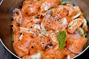 Salmon being prepared for marination