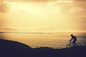 biker riding at sunset