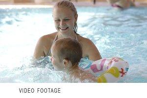 Little child having swimming lessons