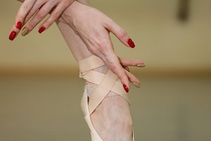 Leg and arms of a ballerina. Pointe