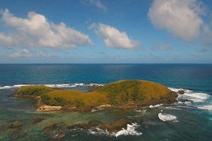 Aerial view Seascape with tropical island, beach, rocks and waves. Catanduanes, Philippines.