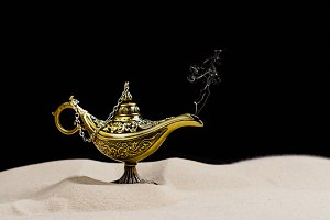 Aladdin magic lamp on the sand