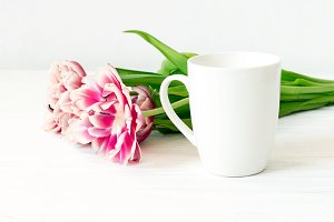 White cup mockup and tulips