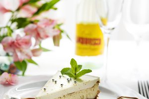 Pieces of delicious homemade cheesecake with mint