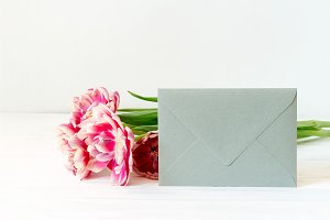 Silver envelope and pink tulips