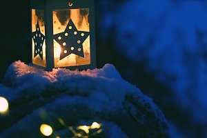 lantern on snowy evening landscape
