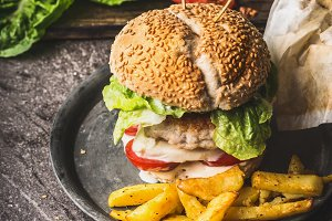 Burger with chicken and french fries