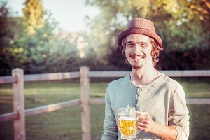 Guy in german hat with mug of beer