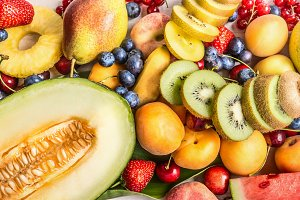 Summer fruits background with melon