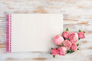 Notepad and small pink roses