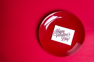 red plate with a card