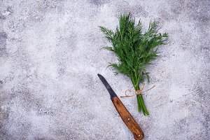 Bunch of fresh dill and knife