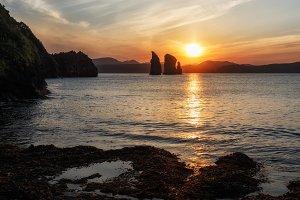 Beautiful sunset over rocks in ocean