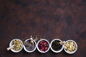 Collection of tea and natural additives in bowls