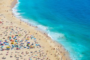 Crowded  ocean beach Nazare Portugal