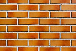 Orange-brown new brick wall texture