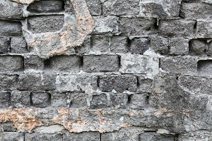 Old weathered brick wall gray color