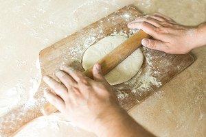 A man rolled raw dough