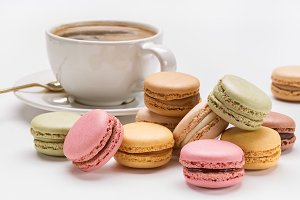 Macaroons and coffee with foam.